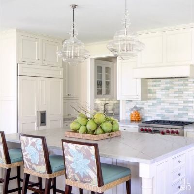 Jill Shevlin Design Vero Beach Interior Designer Creates a colorful Kitchen with a multi colored glass back spalsh